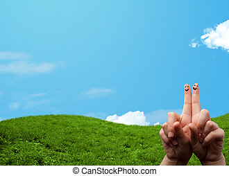 Cheerful happy smiling fingers with landscape scenery at the...