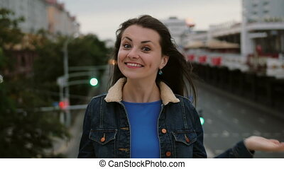 cheerful, happy, smiling girl standing on the bridge, have fun, posing sends kisses looks at the camera. 4K