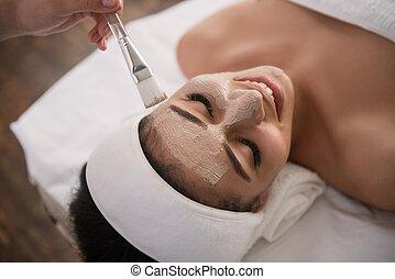 Cheerful happy woman enjoying the beauty procedure