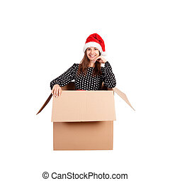Cheerful happy woman in dress and christmas hat having fun while sitting in the big gift box and raises his hands up from happiness. isolated on white background