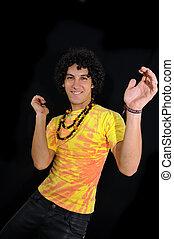 Cheerful hispanic teen dancing on black