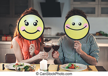 Cheerful husband and wife smiling during romantic dinner