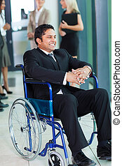 indian businessman in wheelchair