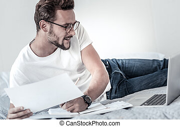 Cheerful intelligent man being involved in work