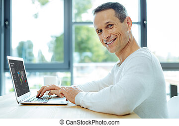 Cheerful intelligent man working