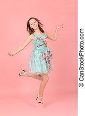 Cheerful jumping girl