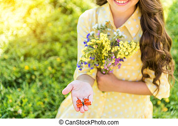 Cheerful kid showing beautiful butterfly