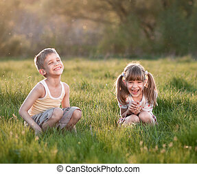 Cheerful kids in the grass