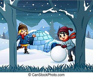 Cheerful kids playing a snow near the igloo house