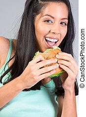 Latina girl eating burger