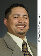 closeup portrait of a cheerful Hispanic male