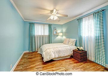 Cheerful light blue bedroom