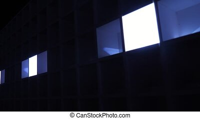 Cheerful light music from rows of lit blue squares in a ...