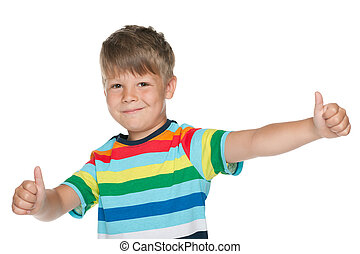 Cheerful little boy holds his thumbs up