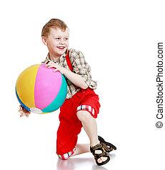 cheerful little boy in a plaid shirt