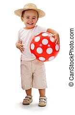 Cheerful little boy in straw hat, holding red dotted ball