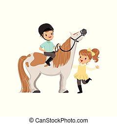 Cheerful little boy jockey sitting on pony horse, beautiful...