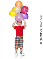 Cheerful little boy with balloons