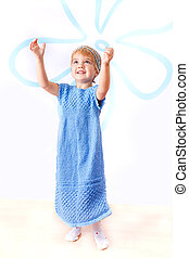 Cheerful little girl in knitted blue dress