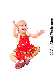 Cheerful little girl in red apron