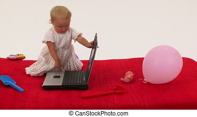Cheerful Little Girl Playing With Laptop