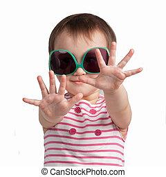 Cheerful little girl wearing glamorous glasses