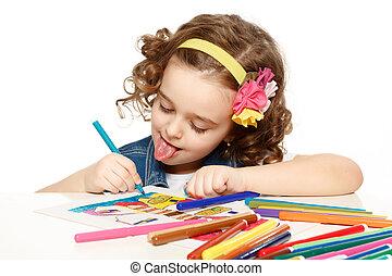 Cheerful little girl with felt-tip pen drawing in kindergarten.