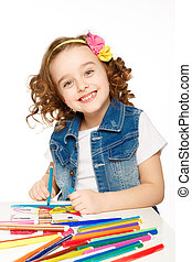 Cheerful little girl with felt-tip pen drawing in...