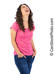 Cheerful long haired brunette posing