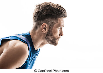 Cheerful male athlete is ready to run