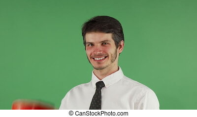 Cheerful male engineer smiling putting on his hardhat