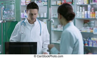 Cheerful male pharmacist reading prescription - Female...