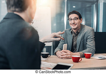 Cheerful male speaking with partner