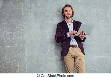 Cheerful male using notebook computer