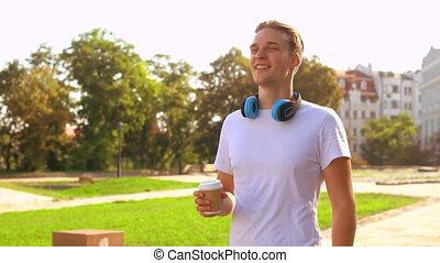 cheerful male walks enjoy drink outdoors