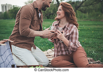 Cheerful man and woman celebrating anniversary in the fresh air