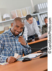 Cheerful man answering the phone