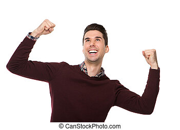Cheerful man celebrating with arms raised