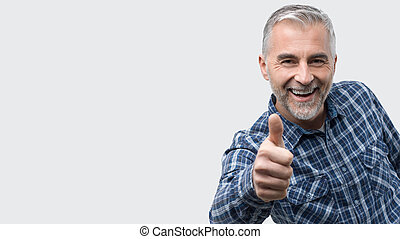 Cheerful man giving a thumbs up