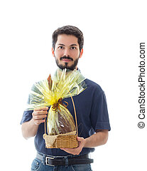 Cheerful man hands out chocolate in the form of Easter egg.
