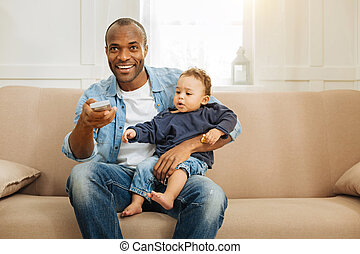 Cheerful man holding a sweet baby