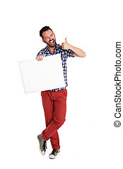 Cheerful man holding blank poster and showing thumbs up