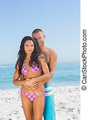 Cheerful man holding his pretty girlfriend