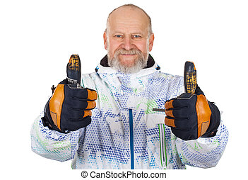 Cheerful man in ski suit showing thumbs up