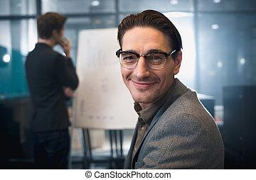 Cheerful man locating at presentation