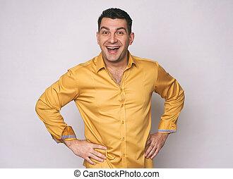 Cheerful man looking at camera. Isolated