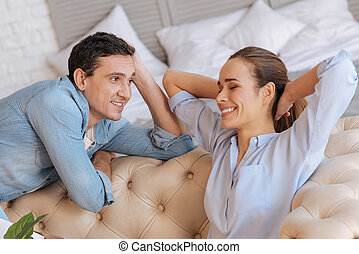 Cheerful man looking at his beautiful happy wife