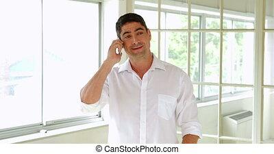 Cheerful man making a phone call
