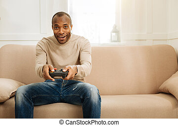 Cheerful man playing a game