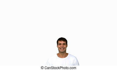 Cheerful man raising arms on white screen in slow motion